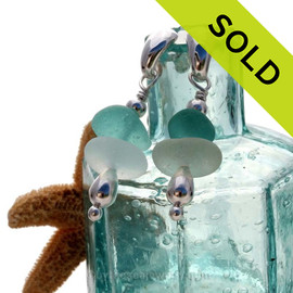 Vivid Aqua and pure white sea glass combined with sterling beads and presented on solid sterling post earrings.