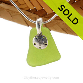 A perfect piece of natural beach found chartreuse or lime green sea glass is combined with a solid sandollar charm and presented on an 18 Inch solid sterling snake chain. Sorry this Sea Glass Jewelry selection is NO LONGER AVAILABLE!
