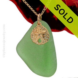 A Larger Thick  Green sea glass necklace is combined with a 14K G/F sandollar charm and comes WITH this 18 Inch 14K Goldfilled curb chain! Sorry this Sea Glass Jewelry selection has been SOLD!