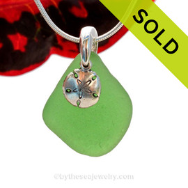 A nice thicker piece of natural beach found vivid green sea glass is combined with a solid sandollar charm and presented on an 18 Inch solid sterling snake chain. Sorry this Sea Glass Necklace has been SOLD!