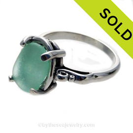This is Natural genuine UNALTERED sea glass just the way it was found on the beach. Instead of traditional gemstones that are altered to fit a setting, we sort through thousands of beach found sea glass pieces to find the P-E-R-F-E-C-T fit for our settings. SOLD - Sorry This ULTRA RARE Sea Glass Ring Is NO LONGER AVAILABLE!