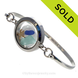 Genuine Sea Glass Locket Bracelet Tiny cobalt blue and aqua genuine sea glass combined with a small sandollar and a starfish in this one of a kind sea glass bangle bracelet!  SOLD, sorry this Sea Glass Jewelry selection is no longer available.