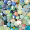 Sea Glass Marbles are a coveted beach find. Possible sources are childrens toys and ballast in the holds of ships.
