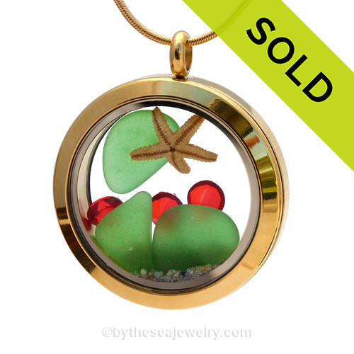 Bright green beach found sea glass combined with a real starfish and finished with vivid red crystals and beach sand make this a great sea glass locket for the holidays! SOLD - Sorry this Sea Glass Locket is NO LONGER AVAILABLE!