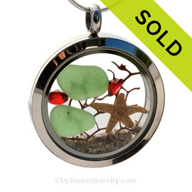 Vivid green beach found sea glass combined with red crystal gems , a bit of seafan and and a real starfish. SOLD - Sorry this Sea Glass Locket is NO LONGER AVAILABLE!