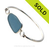 Genuine Sea Glass Bangle Bracelet in a P-E-R-F-E-C-T Sheppy Gray Blue glass set in our Deluxe Wire Bezel© sterling silver setting. SOLD - Sorry this Sea Glass Bangle Bracelet is NO LONGER AVAILABLE!