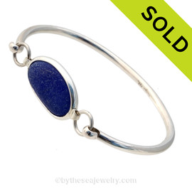 Genuine Sea Glass Bangle Bracelet in a P-E-R-F-E-C-T Vivid Thick Deep Blue glass set in our Deluxe Wire Bezel© sterling silver setting. Sorry this Sea Glass Bracelet is NO LONGER AVAILABLE!