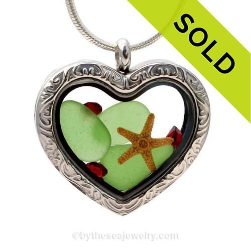 A great Sea Glass Locket to show your love of the beach AND Christmas. Strong magnetic locks secure your treasures inside.  SOLD - Sorry this Sea Glass Jewelry selection is NO LONGER AVAILABLE!