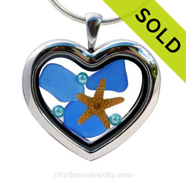 Cobalt Blue sea glass combined a large silver heart locket necklace with aqua pearls.