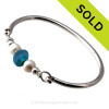 Vivid mixed aqua blue beach found sea glass combined with real cultured pearls on this solid sterling silver FULL round sea glass bangle bracelet.  SOLD - Sorry this Sea Glass Jewelry selection is NO LONGER AVAILABLE!