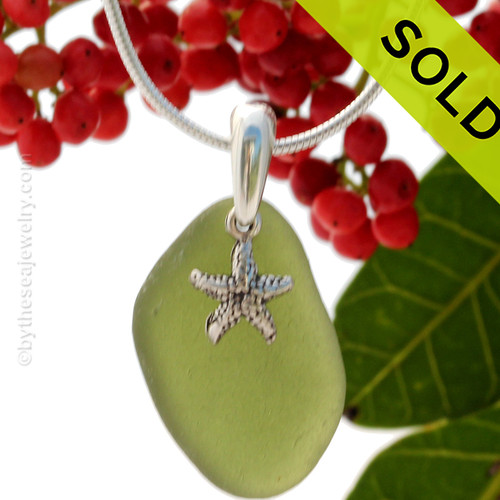 Stunning Bright Jungle Green sea glass set on a solid sterling cast bail with a sterling silver Starfish charm.