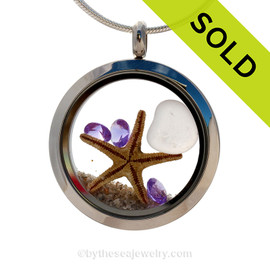 Rare pale purple sea glass heart combined with beach sand ,a real starfish and brightened up with amethyst crystal gems makes this a great choice for a February Birthday!