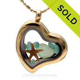 Beautiful pieces of seafoam and aqua sea glass pieces combined with a real starfish. Finished with a real Starfish in this Goldtone Heart Locket Necklace. SOLD - Sorry this Sea Glass Locket is NO LONGER AVAILABLE!