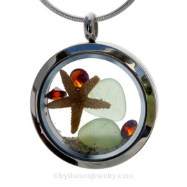 Genuine sea glass in seafoam green  and a real starfish  of sea glass locket necklace. Genuine Garnet gems make this a great gift for any January Beach Baby!
