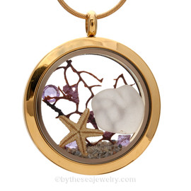 A gold tone stainless steel locket necklace with real winter white beach found sea glass pieces and a real starfish and finished with amethyst crystal gems. Perfect for any February Beach Lover!