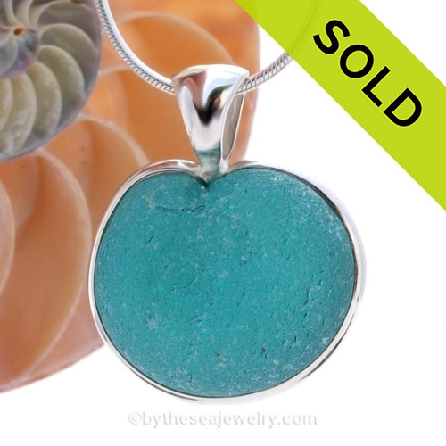ONCE-IN-A-LIFETIME HUGE Natural Sea Glass Heart set in our deluxe wire bezel pendant setting! This piece features the glass and beauty of the teal/aqua sea glass and is presented on a professionally our Deluxe Wire Bezel Setting© that leaves the sea glass UNALTERED from the way it was found on the beach.  SOLD - Sorry this Ultra Rare Sea Glass Pendant is NO LONGER AVAILABLE!