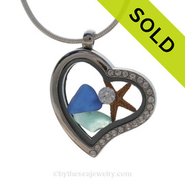 Our new heart lockets make this aqua and blue sea glass really shine! Tiny crystals on the rim for some added bling. CZ crystal and a small starfish make this a great beachy gift!