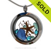 A beautiful pieces of natural cobalt blue and aqua sea glass combined in a stainless steel locket necklace with a real starfish a bit of seafan for an underwater scene and vivid aqua gems for a touch of bling. SOLD - Sorry this Sea Glass Locket is NO LONGER AVAILABLE!