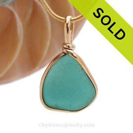An incredible piece of Teal Green Genuine Sea Glass Pendant set for a necklace in our Original Sea Glass Bezel© in 14K Goldfilled.