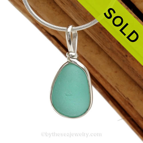A perfect and beautiful beach found Aqua Genuine Sea Glass Pendant in our Original Wire Bezel© Setting in Solid Sterling Silver. SOLD - Sorry this  Sea Glass Pendant is NO LONGER AVAILABLE!