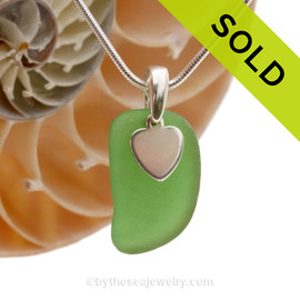 A nice piece of bright green genuine sea glass with a solid sterling bail and simple heart charm. SOLD - Sorry this Sea Glass Necklace is NO LONGER AVAILABLE!