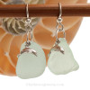 Large pieces of seafoam green sea glass pieces set with LARGE sterling seahorse charms on sterling silver hook earrings.
