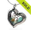 Vivid Aqua sea glass combined a large silver heart locket necklace with Fresh Water Pearls and a bit of vintage seafan