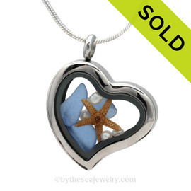 Carolina Blue Beach Found Sea Glass combined a silver heart locket necklace with Fresh Water Pearls and a a baby starfish.
