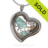 Our new heart lockets make this aqua sea glass really shine! Free Floating and changing like the tide, this piece includes genuine aqua sea glass, a baby starfish, pearls and an aquamarine crystal gem.
