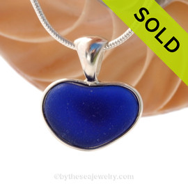 ONCE-IN-A-LIFETIME perfect Natural Sea Glass Heart set in our deluxe wire bezel pendant setting! This piece features the glass and beauty of the teal/aqua sea glass and is presented on a professionally our Deluxe Wire Bezel Setting© that leaves the sea glass UNALTERED from the way it was found on the beach.