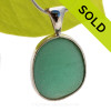 This STUNNING HUGE aqua green  sea glass piece is from England. It is set in a sterling pattern wire with a cast silver bail. Great and will accommodate ANY necklace you may already own. SOLD - Sorry this Rare Sea Glass Pendant is NO LONGER AVAILABLE!!!