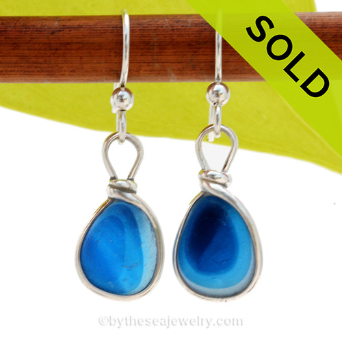 Ultra Rare Mixed sea glass pieces from Seaham England are set in our Original Wire Bezel© earring setting. This is a very hard sea glass to match as the color is cross sectioned from one side to the other. SOLD - Sorry these Ultra Rare Sea Glass Earrings are NO LONGER AVAILABLE!
