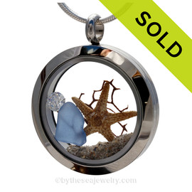"""A Beautiful Carolina Blue Genuine Sea Glass Locket with a real starfish. and beach sand, finished with a vivid brilliant cut CZ gem """"Diamond"""" great for any April Beach Baby! SOLD - Sorry this Sea Glass Locket is NO LONGER AVAILABLE!"""