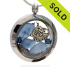 Pieces of Genuine Sea Glass in Carolina Blue , a bit of vintage seafan and blue dyed pearls and a Solid Sterling MOM charm completes this sea glass locket necklace.