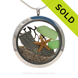 Beautiful pieces of green sea glass pieces combined with a real starfish, seafan and a solid sterling California Sterling Charm. Finished with real beach sand  in this JUMBO 35MM stainless steel locket necklace. SOLD - Sorry this Sea Glass Locket is NO LONGER AVAILABLE!