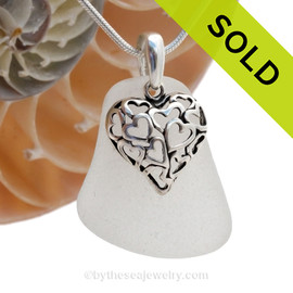 A  perfect  well frosted piece of larger pure White Genuine Sea Glass Necklace with a solid sterling bail and detailed heart in hearts charm. This piece comes complete with our sterling 1.3 MM snake chain. SOLD - Sorry this Sea Glass Necklace is NO LONGER AVAILABLE!