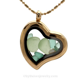 "Beautiful seafoam sea glass pieces combined with aqua glass chips in this Genuine Sea Glass Gold Heart Locket Necklace. Comes with a Free bead and bar PLATED 24 "" Chain ( shown)."
