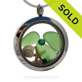 "Beautiful pieces of perfect Genuine Green Sea Glass combined with a Real Starfish and tiny nautilus shell . Finished with crystal gems in this heart locket. Emerald is the birthstone for May. Comes with a Free PLATED 18 "" Chain (not shown)."