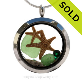 Beautiful pieces of perfect Genuine Green Sea Glass combined with and Two Real Starfish. Finished with crystal emerald gems in this heart locket. SOLD - Sorry this Sea Glass Locket is NO LONGER AVAILABLE!