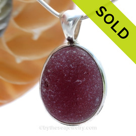 A once in a lifetime piece of HUGE real Purple Sea Glass from Seaham England set in our Original Wire Bezel© Pendant setting. One of the largest red  sea glass pieces we have ever offered for sale. SOLD - Sorry this Ultra Rare Sea Glass Pendant is NO LONGER AVAILABLE!