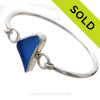 A nice piece of cornflower or periwinkle blue sea glass set in fine and sterling silver in a classic bangle bracelet. SOLD - Sorry this Sea Glass Bangle Bracelet is NO LONGER AVAILABLE!