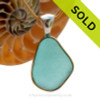 This is a beautiful LARGE P-E-R-F-E-C-T Vivid Bright Aqua Blue Sea Glass set in our Mixed Deluxe Tiffany Wire Bezel© pendant setting. This is our Deluxe Wire design that leaves the glass UNALTERED from the way it was found on the beach. SOLD - Sorry this Rare Sea Glass Pendant is NO LONGER AVAILABLE!