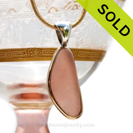 This small slice of peach sea glass is set in a mixed metal gold and sterling silver Deluxe Wire Bezel setting. Very Versatile and elegant. CLASSIC! This setting leaves this amazing natural sea glass piece just the way it was found on  the beach! SOLD - Sorry this Ultra Rare Sea Glass Pendant is NO LONGER AVAILABLE!