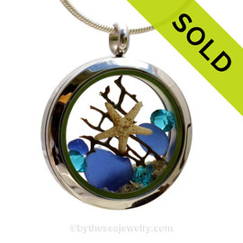 "Beautiful piece of cobalt blue genuine sea glass piece combined with a real starfish and vintage seafan . Finished with a vivid brilliant cut Zircon gems ""and finished with real beach sand. SOLD - Sorry this Sea Glass Locket is NO LONGER AVAILABLE!"