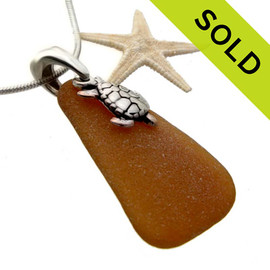 A perfect triangle of amber brown sea glass set on a cast solid sterling silver bail with a sterling sea turtle charm. SOLD - Sorry this Sea Glass Necklace is NO LONGER AVAILABLE!