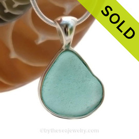 A smaller piece of Vivid Aqua Blue Genuine Sea Glass in our In Our Deluxe Sterling Wire Bezel© Necklace Pendant. SOLD - Sorry this Rare Sea Glass Pendant is NO LONGER AVAILABLE!