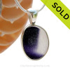 A vivid mix of Vivid Deep Purple in a base of pure white endoday sea glass from England set in our Deluxe  Wire Bezel© necklace pendant setting. SOLD - Sorry this Ultra Rare Sea Glass Pendant is NO LONGER AVAILABLE!