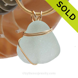 A perfect thick piece of vivid sea water green beach found sea glass in a wire wrapped necklace pendant. SOLD - Sorry this Sea Glass Pendant is NO LONGER AVAILABLE!