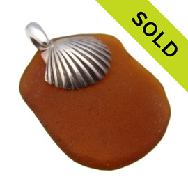 Simple and beachy this Certified Genuine amber brown sea glass pendant is complimented by a LARGE solid sterling silver top quality Sea Shell charm. SOLD - Sorry this Sea Glass Pendant is NO LONGER AVAILABLE!