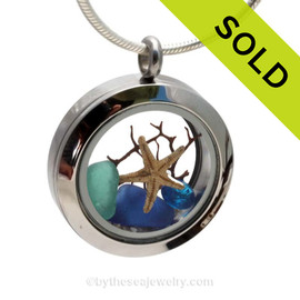 A BEAUTIFUL Natural Cobalt Blue and Aqua beach found Sea Glass Mini Locket Necklace with a real starfish and Vivid Blue Crystal Gem.